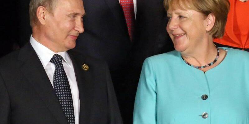 Putin und Merkel - Foto: Alexei Druzhinin/Sputnik/Archiv