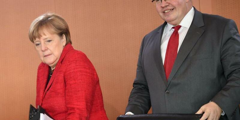 Merkel und Altmaier - Foto: Britta Pedersen
