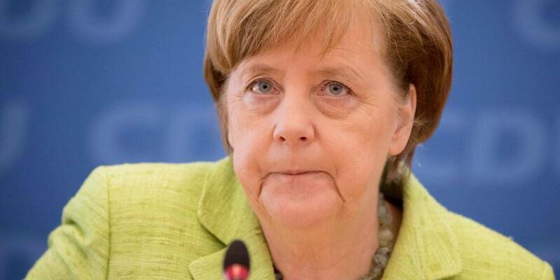 Merkel - Foto: Kay Nietfeld
