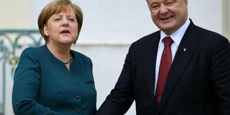 Merkel und Poroschenko in Meseberg - Foto: Der Krieg im Kohlerevier Donbass stand an erster Stelle bei Poroschenkos Gespräch mit Merkel. Foto:Ralf Hirschberger