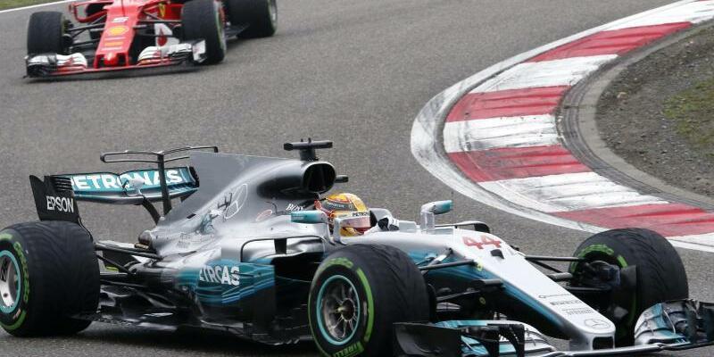 Hamilton und Vettel - Foto: Toru Takahashi