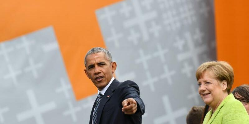 Obama + Merkel - Foto: Ralf Hirschberger