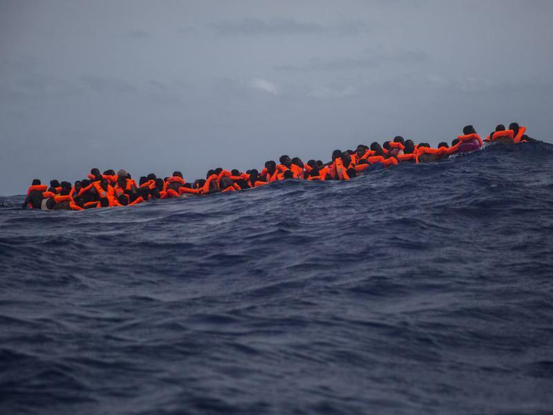 Migranten aus Libyen - Foto: Santi Palacios