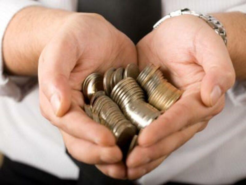 Geld in der Hand - Foto: iStockphoto.com / kutaytanir