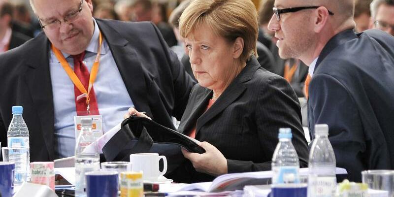Altmaier, Merkel und Tauber - Foto: Darf Kanzleramtschef und CDU-Stratege Altmaier (l) federführend das Wahlprogramm seiner Partei mitgestalten? Foto:Daniel Naupold