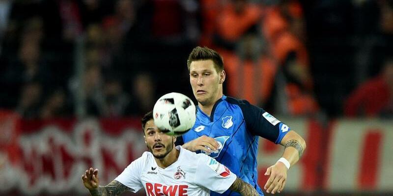 Zweikampf - Foto: Kölns Leonardo Bittencourt (l) und Hoffenheims Niklas Süle kämpfen um den Ball. Foto:Jonas Güttler