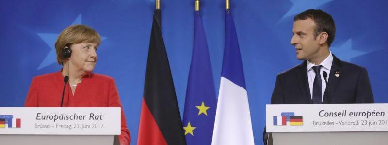 Merkel und Macron - Foto: Olivier Matthys