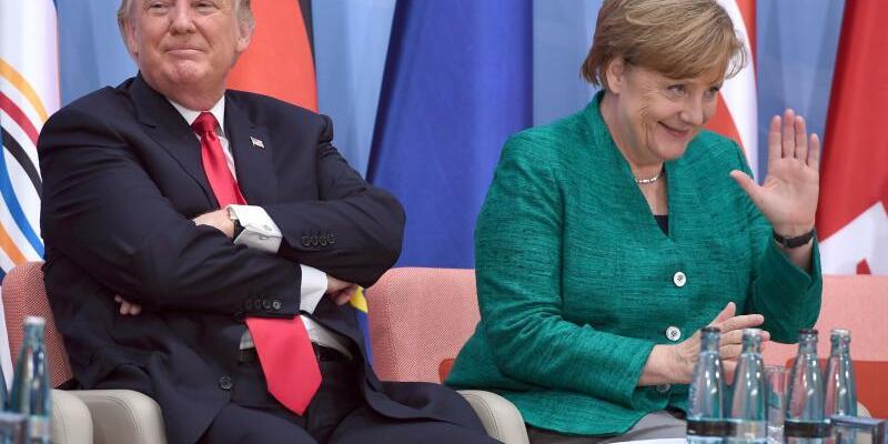 Trump und Merkel - Foto: Patrik Stollarz