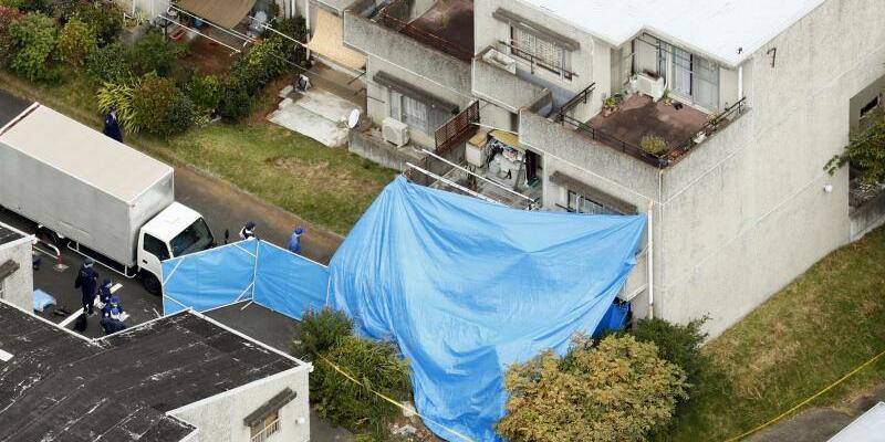 Tatort - Foto: Die Ehefrau, vier Jungen und ein Mädchen wurden in der ausgebrannten ersten Etage gefunden. Foto:Shin Kigeuchi