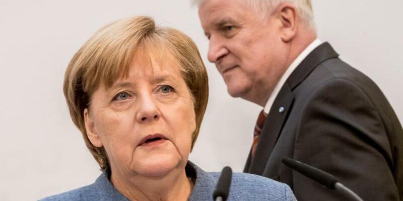 Merkel und Seehofer - Foto: Michael Kappeler