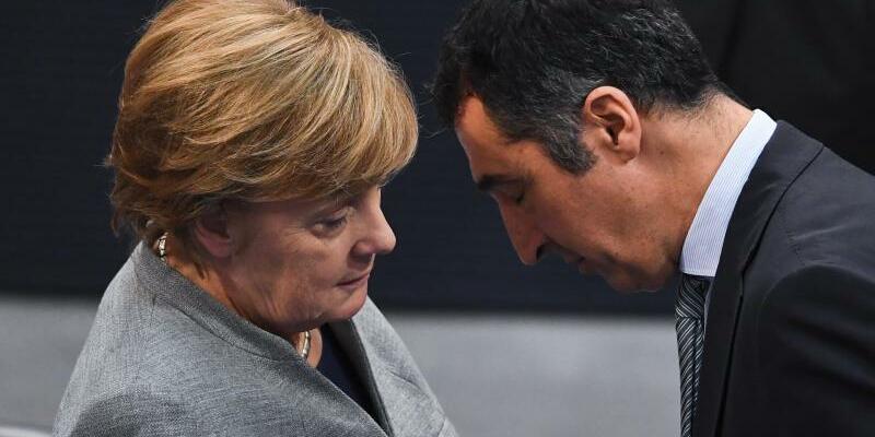 Merkel und Özdemir - Foto: Ralf Hirschberger