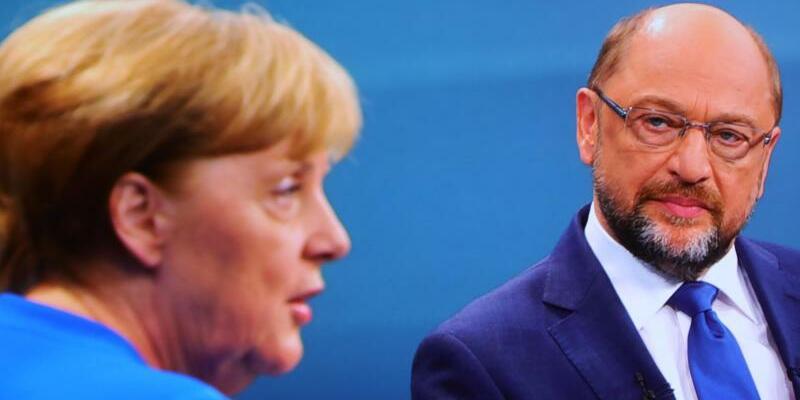 Angela Merkel und Martin Schulz - Foto: Michael Kappeler/Archiv
