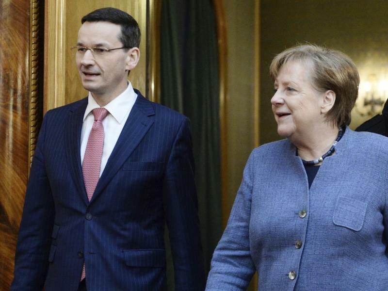 Merkel in Warschau - Foto: Alik Keplicz/AP