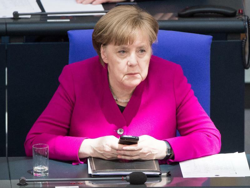 Merkel - Foto: Christophe Gateau