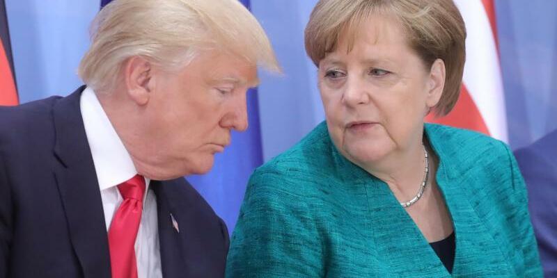 Donald Trump und Angela Merkel - Foto: Michael Kappeler