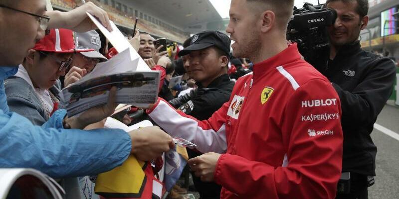 Ferrari-Pilot - Foto: Andy Wong/AP