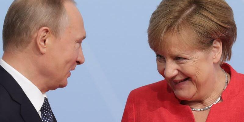 Merkel und Putin - Foto: Michael Kappeler/Archiv
