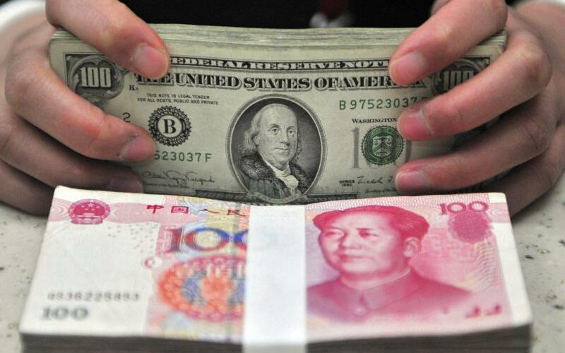 Yuan und Dollar - Foto: Mark/EPA