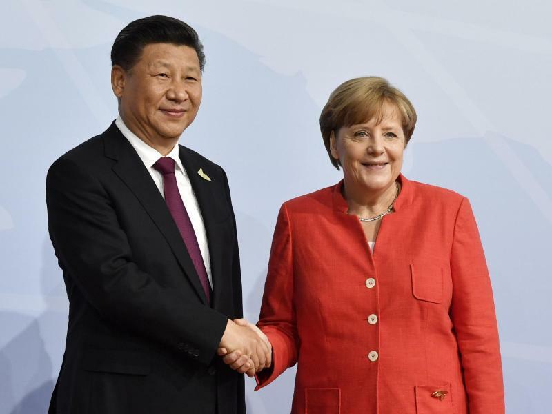 Xi und Merkel - Foto: John Macdougall/AFP Pool/Archiv
