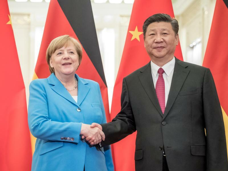 Merkel in China - Foto: Michael Kappeler