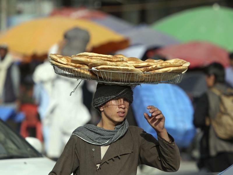 Meister der Balance - Foto: Rahmat Gul, AP
