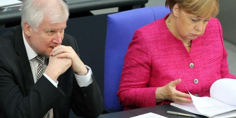 Seehofer und Merkel - Foto: Wolfgang Kumm