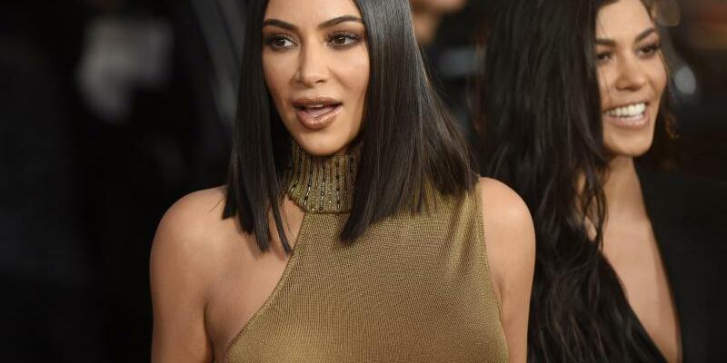 Kim + Kourtney Kardashian - Foto: Chris Pizzello