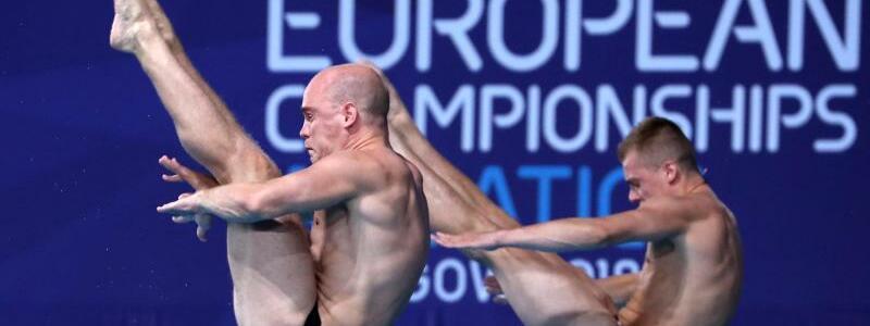 Rang vier - Foto: Timo Barthel (r) und Florian Fandler blieben beim Synchronspringen vom Turm ohne Medaille. Foto:Jane Barlow/PA Wire