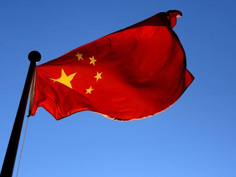 Chinesische Flagge - Foto: China versucht seit Jahren, mit Hilfe von Firmenkäufen ausländische Spitzentechnologie zu übernehmen. Foto:Oliver Berg