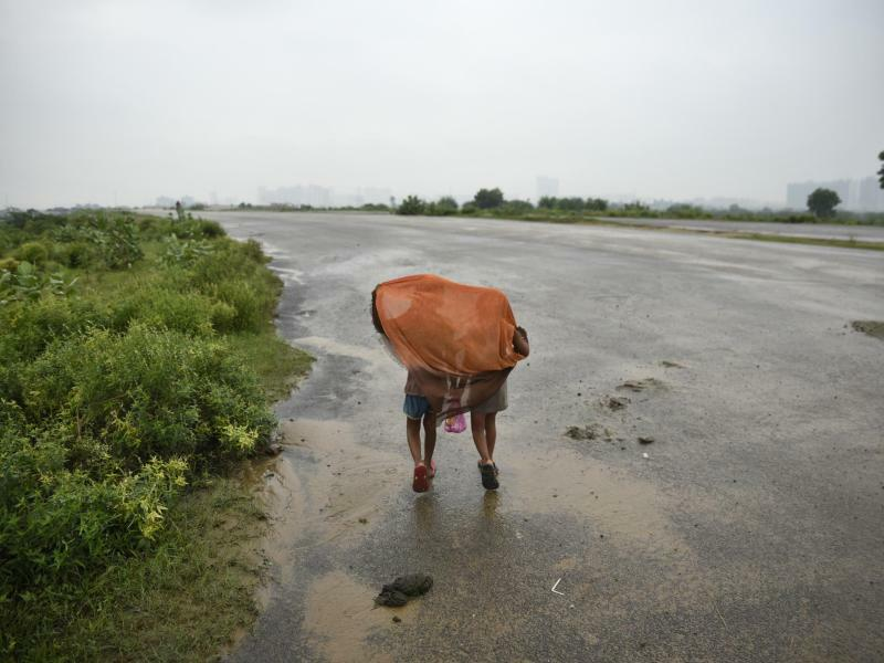 Regenschutz - Foto: R S Iyer, AP