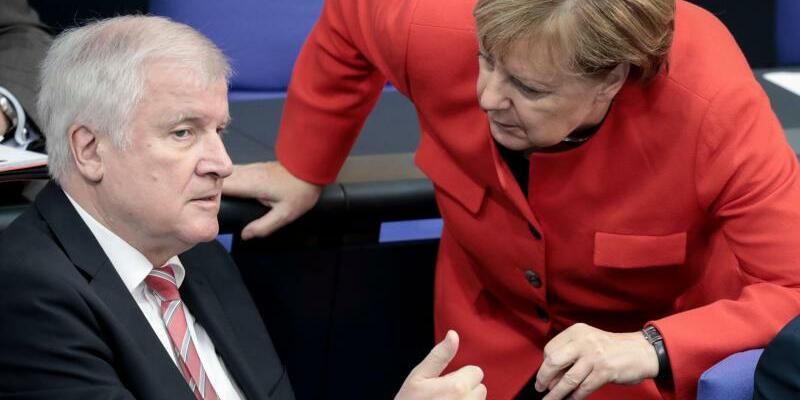 Seehofer und Merkel - Foto: Kay Nietfeld