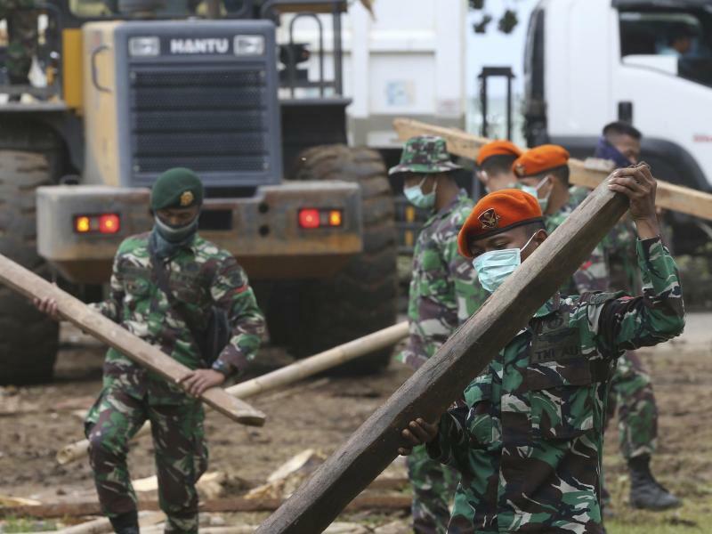 Aufräumen - Foto: Achmad Ibrahim/AP