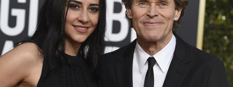 Golden Globes - Dafoe & Colagrande - Foto: Jordan Strauss/Invision/AP