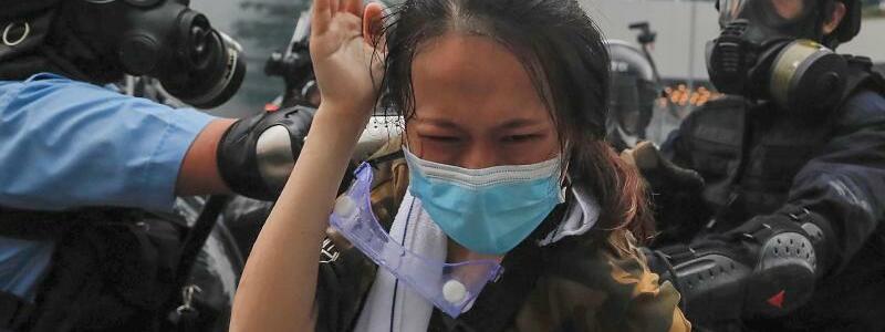 Zugriff - Foto: Kin Cheung/AP