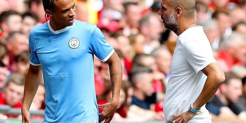 Sané und Guardiola - Foto: Martin Rickett/PA Wire