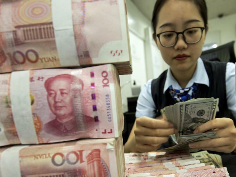 Yuan auf Talfahrt - Foto: CHINATOPIX/AP