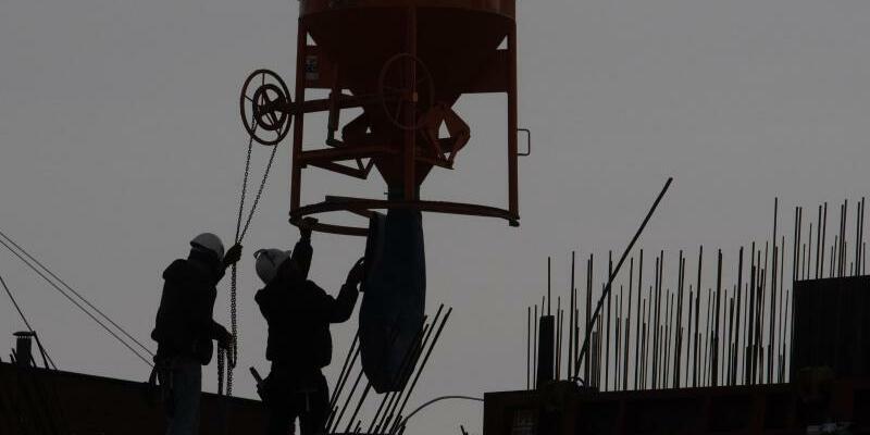 Bauarbeiter - Foto: Paul Zinken/dpa