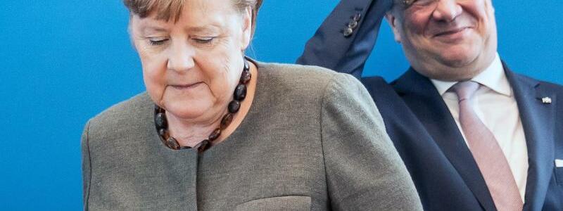 Merkel und Laschet - Foto: Michael Kappeler/dpa