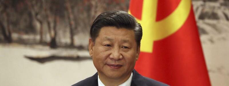 Chinas Staatschef  Xi Jinping - Foto: Ng Han Guan/AP/dpa