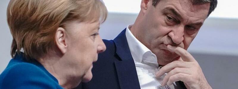 Merkel und Söder - Foto: Michael Kappeler/dpa