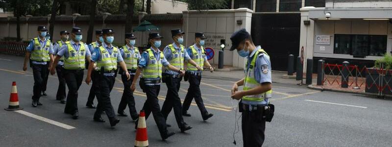 China räumt Konsulat - Foto: Ng Han Guan/AP/dpa