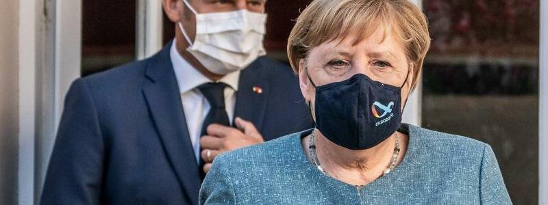 Merkel und Macron - Foto: Michael Kappeler/dpa