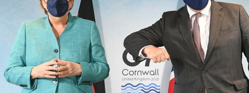 Merkel und Johnson - Foto: Stefan Rousseau/PA Wire/dpa