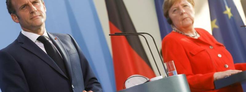 Treffen Merkel und Macron - Foto: Axel Schmidt/Reuters-Pool/dpa