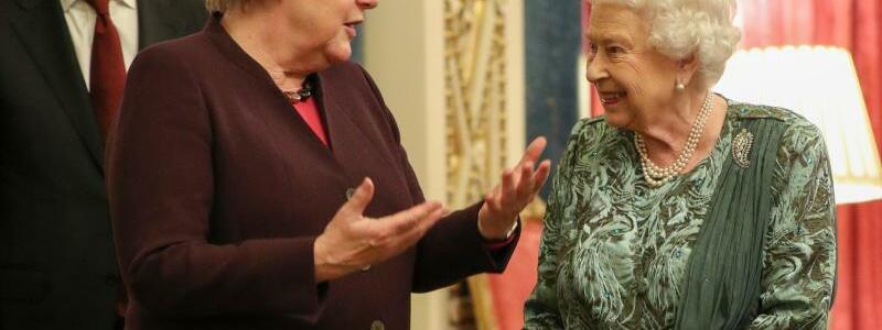 Angela Merkel und Queen Elizabeth II. - Foto: Yui Mok/PA Wire/dpa