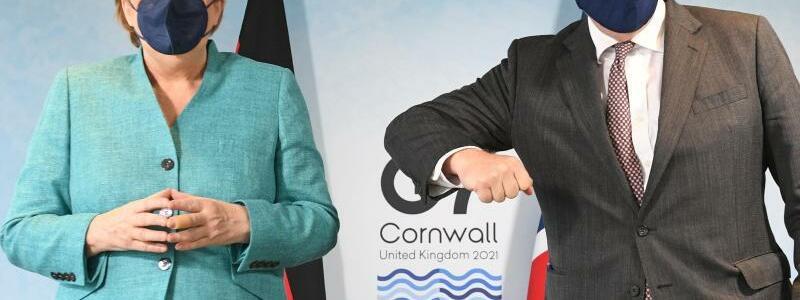 Angela Merkel und Boris Johnson - Foto: Stefan Rousseau/PA Wire/dpa