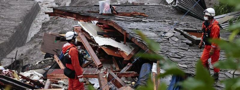 Rettungstrupp - Foto: Uncredited/Kyodo News/AP/dpa