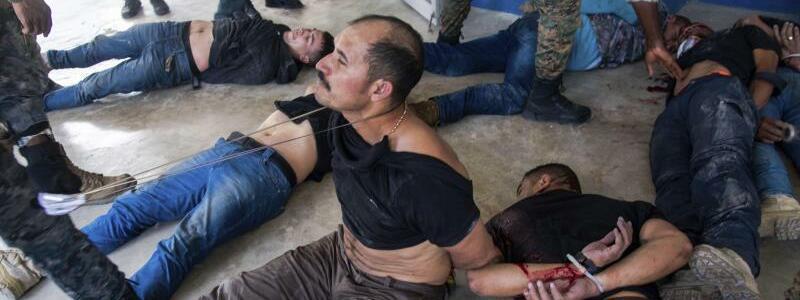 Festnahmen - Foto: Jean Marc Herv? Ab?lard/AP/dpa