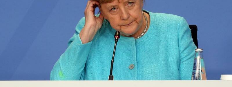 Pressekonferenz Merkel - Foto: Wolfgang Kumm/dpa-Pool/dpa