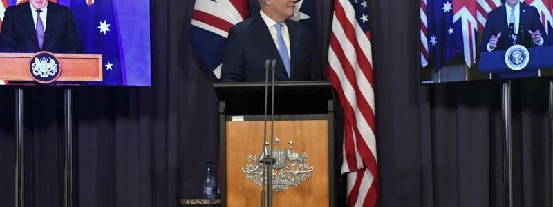 Boris Johnson,  Scott Morrison und Joe Biden - Foto: Mick Tsikas/AAP via AP/dpa